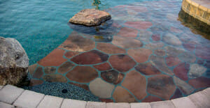 Flagstone tanning shelf with protruding rock water feature, Cave Creek AZ