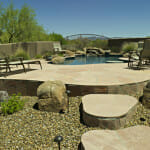 Natural rock waterfall, in-pool table, flagstone cut out for umbrella, Phoenix AZ