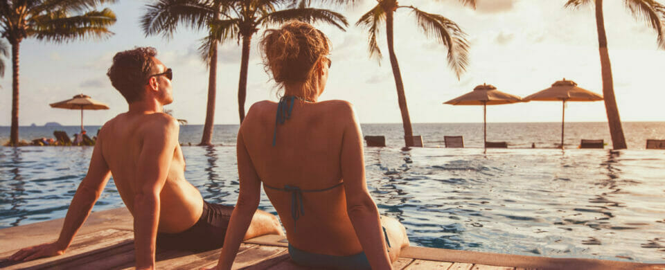 Couple having a getaway and spending time in swimming pools.